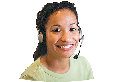 Female employee with headset looking up and smiling