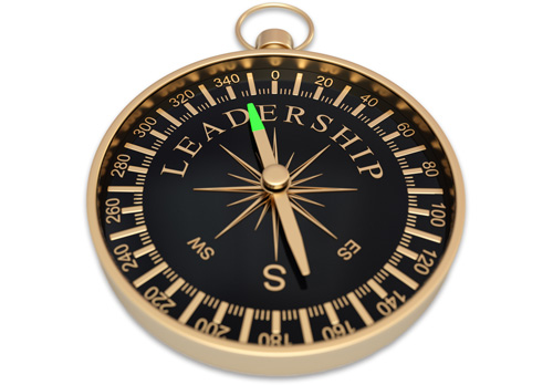 Gold and black compass with the word Leadership on its face